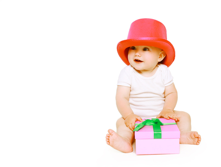 tot: Funny positive baby having fun with toys