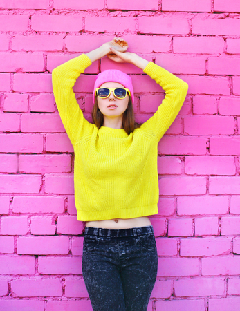 Fashion portrait pretty woman over colorful pink background Stok Fotoğraf