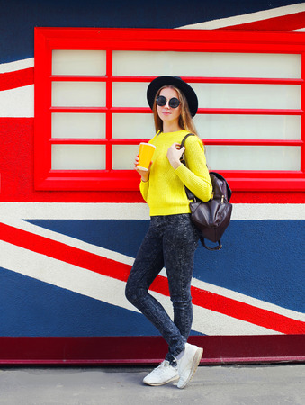 Fashion pretty woman with cup over urban colorful background Stok Fotoğraf