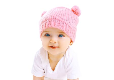 pink hat: Portrait cute smiling baby in knitted pink hat on white background Stock Photo