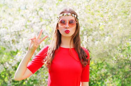 hippie woman: Fashion beautiful hippie woman having fun in flowering garden Stock Photo