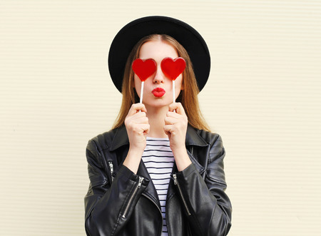 Fashion pretty sweet woman having fun with lollipop over white background