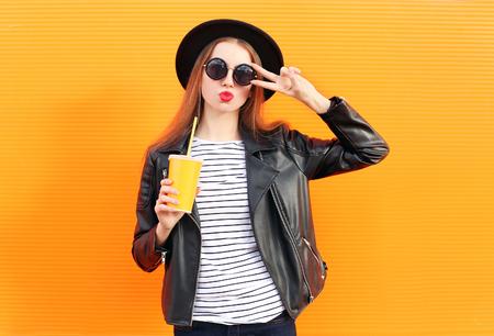 Fashion pretty woman in black rock style having fun over orange background Stok Fotoğraf