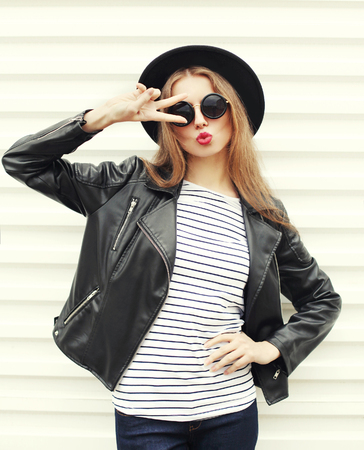 Fashion pretty woman in black rock style having fun over white background Stok Fotoğraf