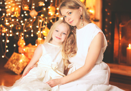 fireplace home: happy mother and child near christmas tree with fireplace home