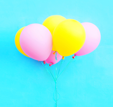 a colorful bundle of air balloons on a blue background