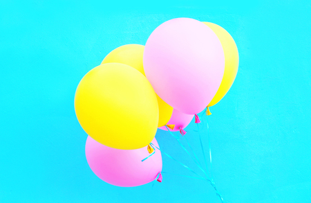 Colorful bundle of air balloons on a blue background Stock Photo
