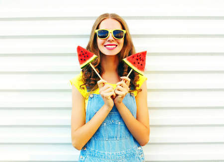 Portrait happy smiling woman with a two slice of watermelon in the form of ice cream over a white background Stock Photo
