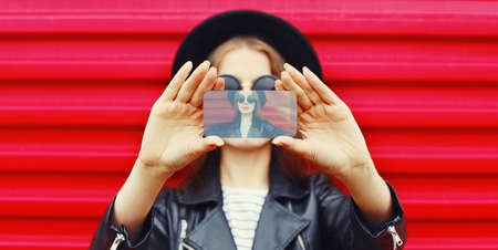 Close-up woman taking selfie picture by smartphone over wall background Stok Fotoğraf - 152443804