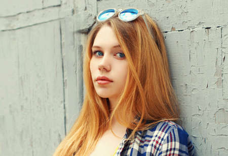 Close up portrait of blonde teenager girl looking at camera Stok Fotoğraf - 155853369