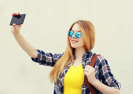 portrait of smiling teenager girl taking selfie picture by phone Stok Fotoğraf