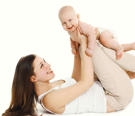 Happy smiling mother and baby playing together over a white background