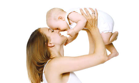 Portrait of happy smiling mother and baby playing together over a white background