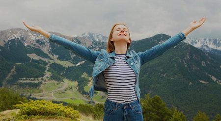 Travel image woman enjoying fresh air mountains raising her hands up on a Andorra background Stok Fotoğraf