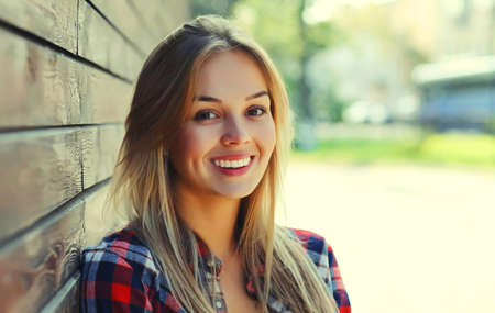 Portrait of beautiful happy smiling young woman in a city Stok Fotoğraf