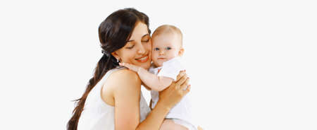 Portrait of happy smiling mother hugging her baby on a white background