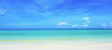 white sand beach: Pristine white sand beach, sea & blue sky meeting in horizon