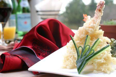 jumbo shrimp: Jumbo shrimp and fresh vegetables lightly battered. Hot and crisp, served with tempura sauce. Shallow DOF.