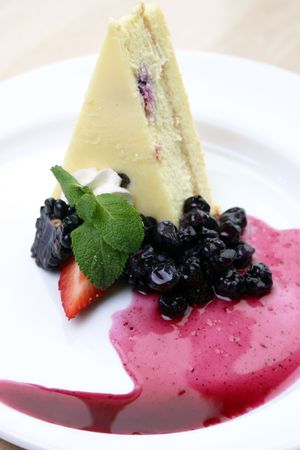 wildberry: Wildberry cheesecake served with raspberry puree and wildberries. Shallow DOF. Stock Photo