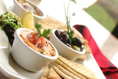 Sumptious platter of flat breads served with red pepper hummus dip, crab dip, olives and grilled haloumi cheese. Shallow DOF. Stock Photo - 220562