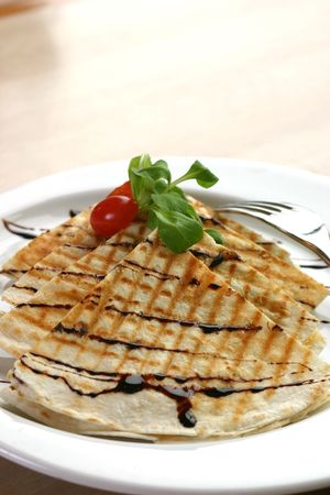 balsamic: Three cheese chicken quesadilla, drizzeled with balsamic vinager. Shallow DOF Stock Photo