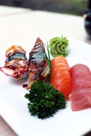 Fresh tuna, atlantic salmon and jumbo shrimp individually hand pressed with rice. Served with wasabi sauce. Shallow DOF. Stock Photo - 220555