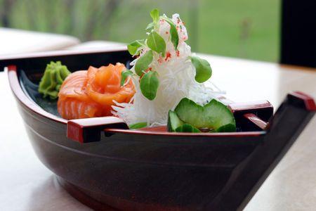 Chefs selection of fresh tuna, atlantic salmon, jumbo shrimp and crab. Shallow DOF. photo