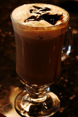 Coffee mocha drink topped with chocolate syrup