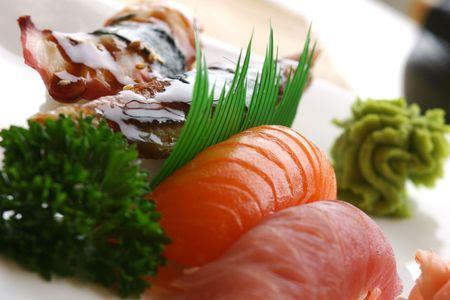 Fresh tuna, atlantic salmon and jumbo shrimp individually hand pressed with rice. Served with wasabi sauce. Shallow DOF.