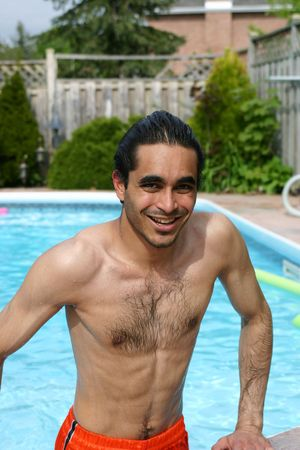 Attractive man at the poolside