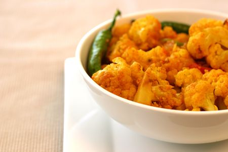 Tradition Indian dish of cauliflower (gobi) garnished with green chillies.