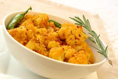 Tradition Indian dish of cauliflower (gobi) garnished with green chillies and rosemary.