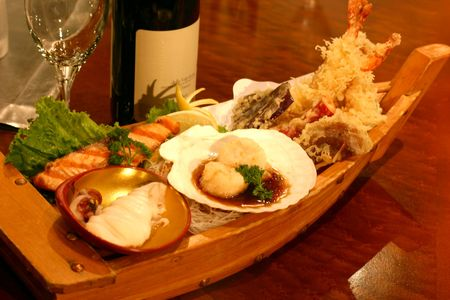 shrimp boat: Boat sushi with an assortment of delicacies. Stock Photo