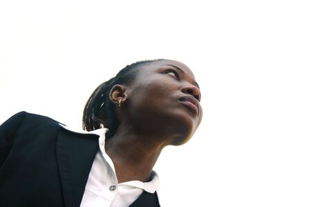 looking upwards: Black businesswoman looking upwards