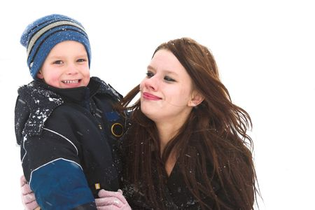 A mother and son have the time of their life playing in the snow Stock Photo - 311511