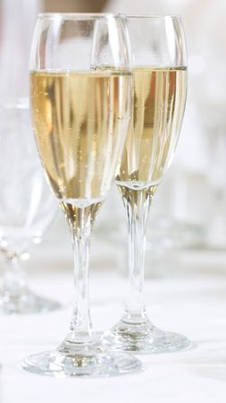 2 flutes with champagne. Focus on the glass at the back. photo