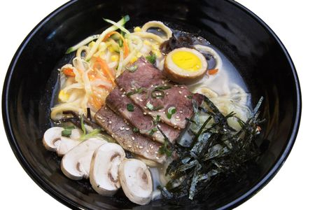 Delicious Ramen stew made from beef, noodles, chicken broth, mushrooms, corn and eggs. photo