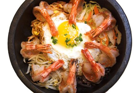 Traditional Korean delicacy made with vegetables and shrimp, served with fried egg and garnished with sesame seeds and chopped green onions.