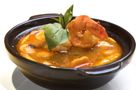 Traditional Thai Tom-Yom soup made from jumbo shrimps and mushrooms.