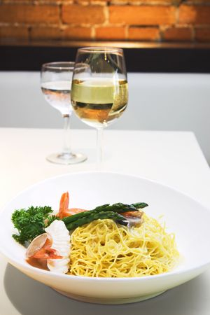 Delicious seafood fried noodles with shrimps, fish, squid and mushroom. Served with asparagus.