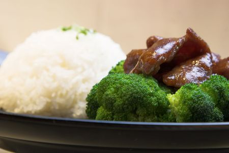 The classic dish of beef, broccoli and steamed rice. photo