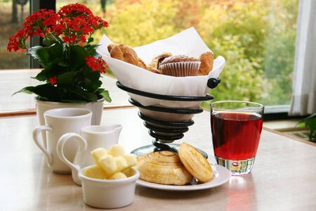 danish: Breakfast of muffins, croissants, danish pastries, cranberry juice and coffee