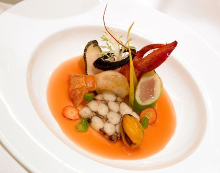 fume: Octopus Terrine, poached scallop mousse, with tuna belly, steamed butter mussels,  langoustine and tomato lobster fume