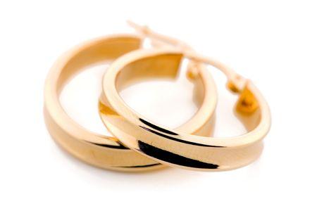 Paar goldene Ohrringe Standard-Bild - 539672