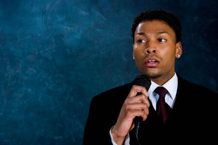 declaration: An African American man in a business suit makes a speech. Stock Photo