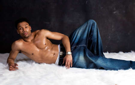 Muscular African-American man on a rug Stock Photo - 685285