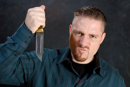 Man with a knife in a murderous rage