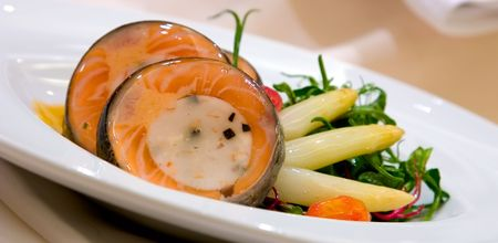atlantic salmon wrapped around a scallop and lobster mousse. Accompanied with white asparagus and sauteed pea tendrils, cherry tomato, carrots, potato and scallion cake Stock Photo - 685320
