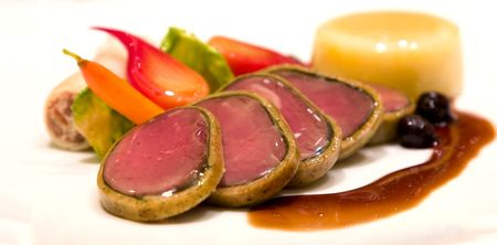 scrumptious: Oven roasted elk tenderloin with spinach and hazelnut crust. Served with braised bison and marscapone cannelloni and stuffed potato