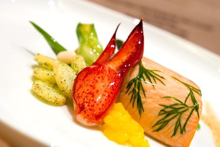 mouthwatering: Steamed salmon stuffed with bok choy. Served with lobster and scallops, butter poached lobster with mango and herbed potatoes and beans.